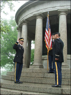 MAJ Ben Smith is shown administering the oath as 2LT Matthew Palumbo holds the American Flag