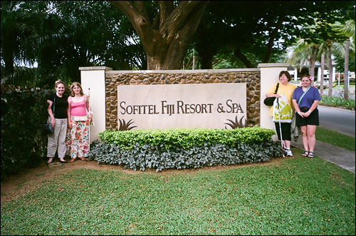 At the marquee of the resort in Fiji. From left are students Ellis Leago and April Jones, as well as Dr. Nancy Badger, and student Gemma Appeldoorn.