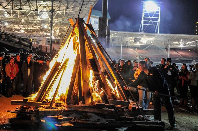 Mocs Football Coach Russ Huesman lighting the fire