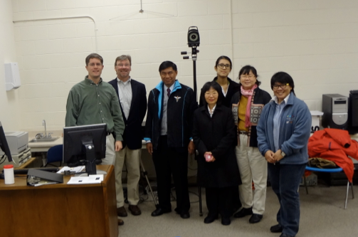 Dr. Jeremiah Tate and Dr. David Levine of the Physical Therapy Department discussing motion analysis in the H. Carey Hanlin Motion Analysis Laboratory with visiting professors from Thailand who have just acquired a motion analysis system.