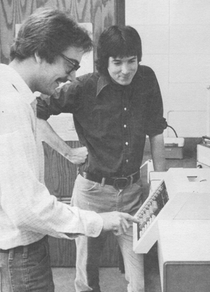 Student Barry Minnick (left) and Dr. Greg Grant check out the coolest piece of equipment at UTC in 1981