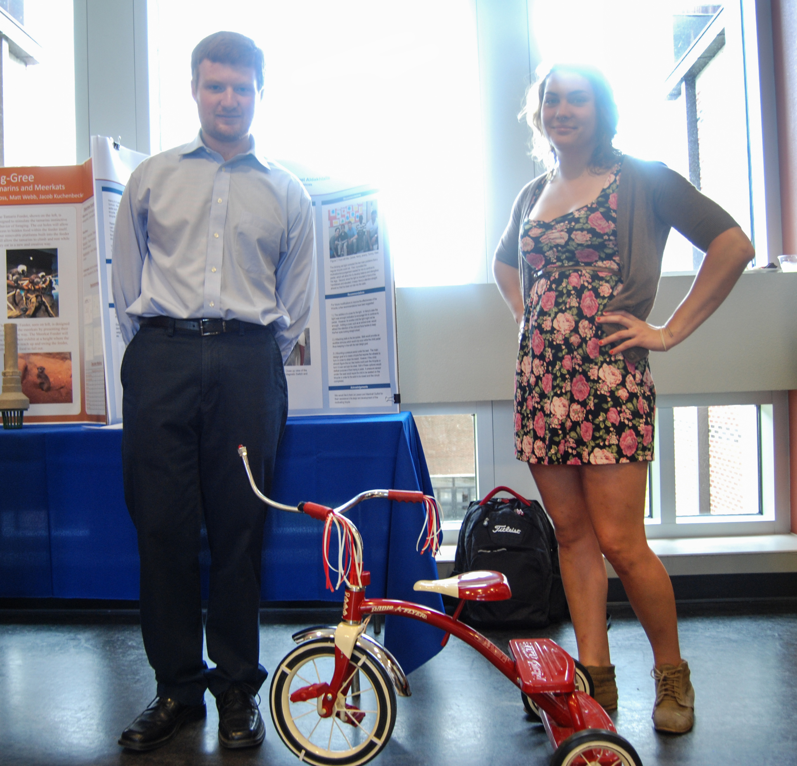 Students Jeremy Lawson and Anastasia Sharp pose next to the tricycle they modified for East Ridge Elementary