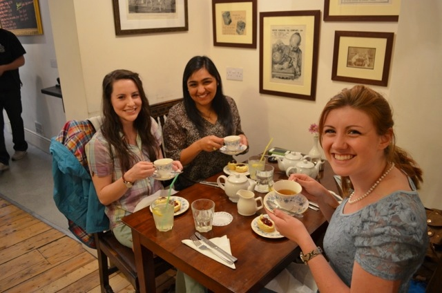 Sipping beloved brew in a traditional English tea room, from left:  Erin Myers, Saba Munir, Kayla Kirkendall