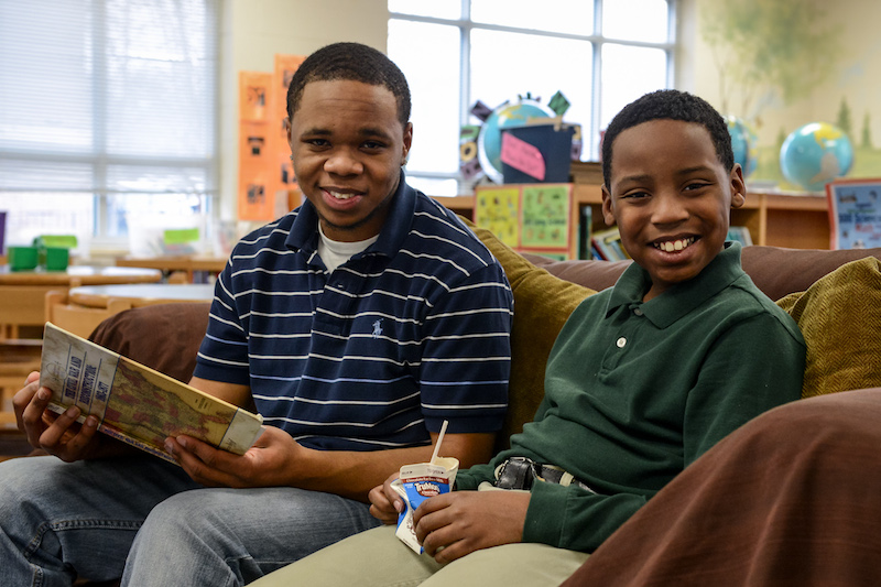 From left to right: UTC student Chris Whitehead reads with his Little Brother Jalanden