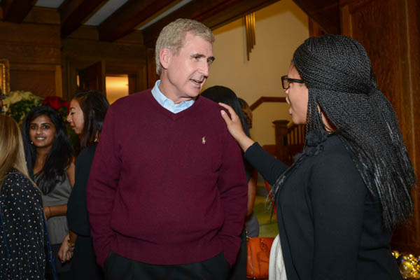 Chancellor Angle talks with students during the annual Student Holiday Party