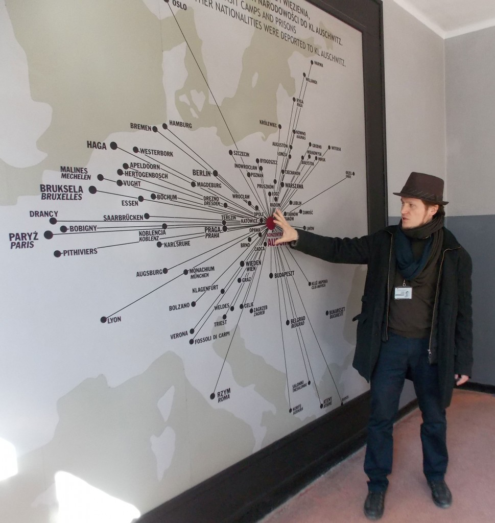 The tour guide for the UTC group, Tomasz, shows a diagram of the towns where prisoners lived before they came to Auschwitz.