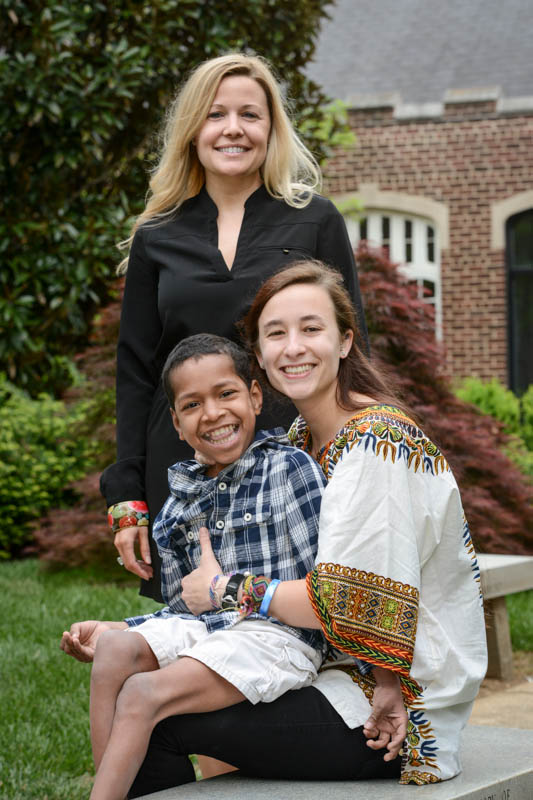 UTC student Kayla Austin (sitting) holds Esteven. Katie Wilson, adjunct professor in Non Profit Management, stands behind her.