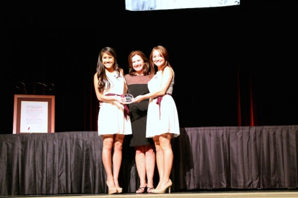 UTC students Tina Nguyen (left) and Kat Brewer (right) receive the Standards of Excellence Award from Cheri Morrell De Jong (center), National President of Sigma Kappa, at the organization's national convention in Las Vegas.