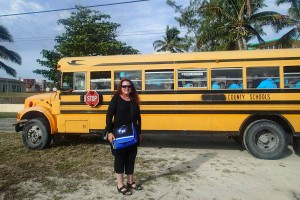 Leah Keith-Houle in front of School Bus