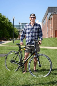 Man with Bicycle on Campus