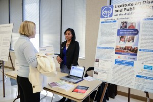 Visitors Talk with Booth Attendant at Accessible Technology Fair