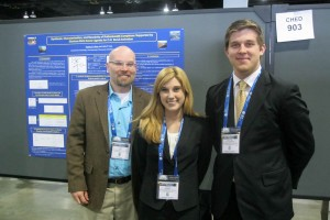 Lee, Latendresse, and Riner stand in front of Chemistry research