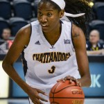 UTC Women's Basketball player dribbling