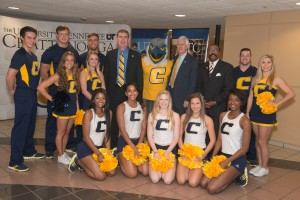Chancellor Angle, Comissioner Bill Gibbons, Scrappy Moc and UTC Cheerleaders pose for group picture