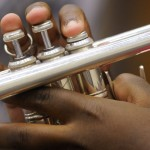 detail photo of trumpeters' hands on the instrument