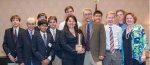 Veronica Herrera with students, winning La Paz's Chattanooga Choice Leadership Award.