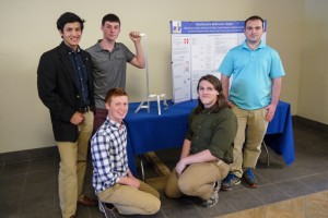 Engineering team consisting of Hector Gutierrez, Cody Flowers, Erik Dale, Nick Pierson, Dillon Grider posing with the assistive device they created.