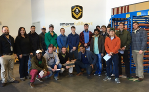 UTC engineering students photographed during a tour of the Amazon facility