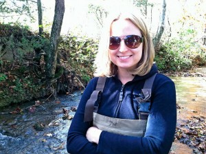 Hope Klug in waders in a creek