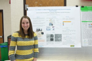 """UTC Student Megan Downs with her poster, """"Cost-Effective Synthesis of Iron Oxide Nanoparticles Towards Sustainable Nanotechnology"""" at Research Dialogues 2016"""