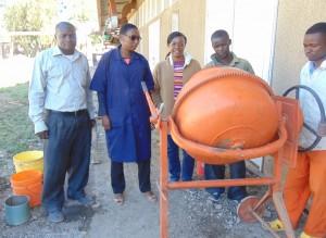 Research Team at MUST: Mr. Joseph Mnkeni and Ms. Shamsa Nassibu, Instructors at MUST; Dr. Mbaki Onyango Ass. Prof at UTC and Ayubu Daniel and Isaya Benard, helping with block making.