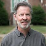 Dr. Greg O'Dea, posing for a headshot on an overcast day.