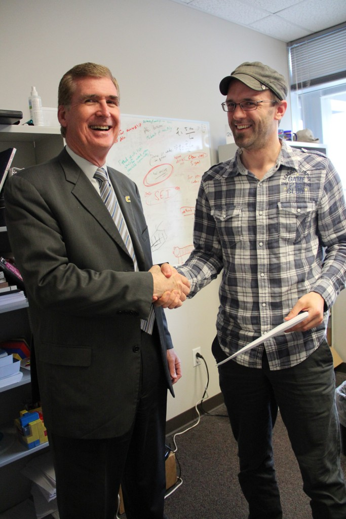 Chancellor Steven Angle with March recipient, Ethan Hereth