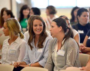 students listen to teachers speak