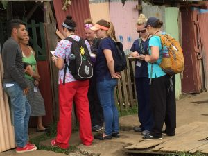 UTC students going door to door to invite people to come out to the clinic.