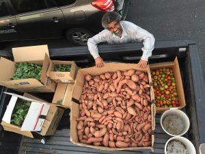 Dr. Jose Barbosa, loading up produce.