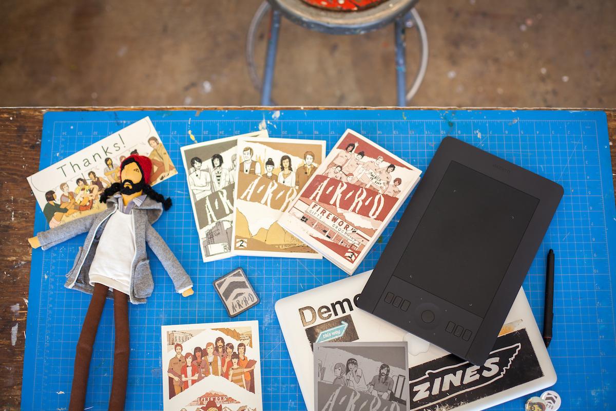Tara Hamilton's work desk with comics laid out