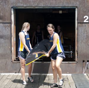 Women's Novice 4+ Rowing team at UTC carrying their boat