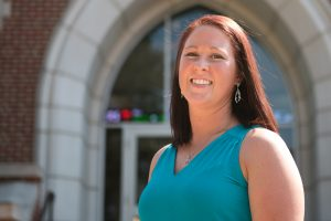 Melissa Speed poses in front of Founders Hall