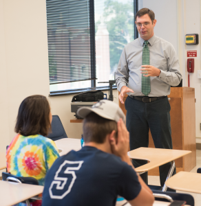 ACT test prep instructor Ryan Gallagher works through a problem with students July 2017