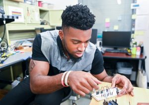 Football? Engineering? Wil Young chose both … and made history