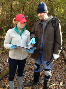Professor Reynolds and a student recording data
